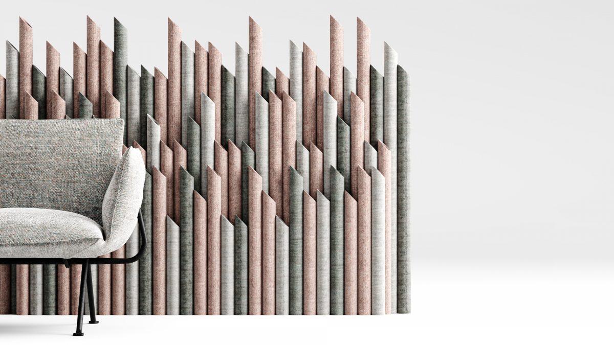 T-wall, rivestito con due tonalità di grigio e una di rosso mattone, posizionato dietro ad una poltrona grigia