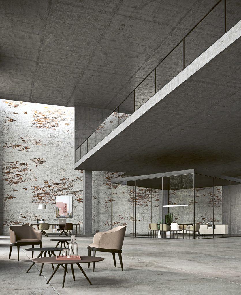 Render generale di un ambiente in cemento grezzo con un muro in mattoni all'interno del quale troviamo alcune sedie e tavoli Imperial Line