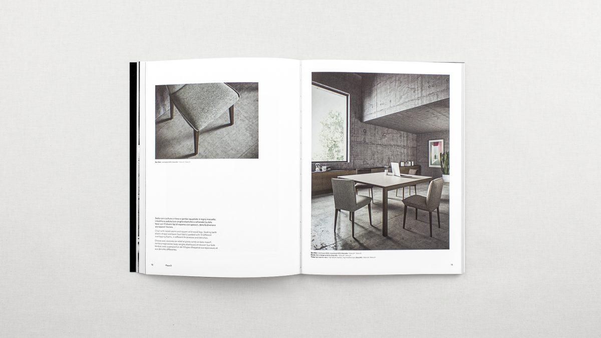 Foto del catalogo aperto che mostra le pagine inerenti alla sedia Bon Bon con breve testo e due render della sedia, uno ambientato in un ufficio e uno di dettaglio del prodotto