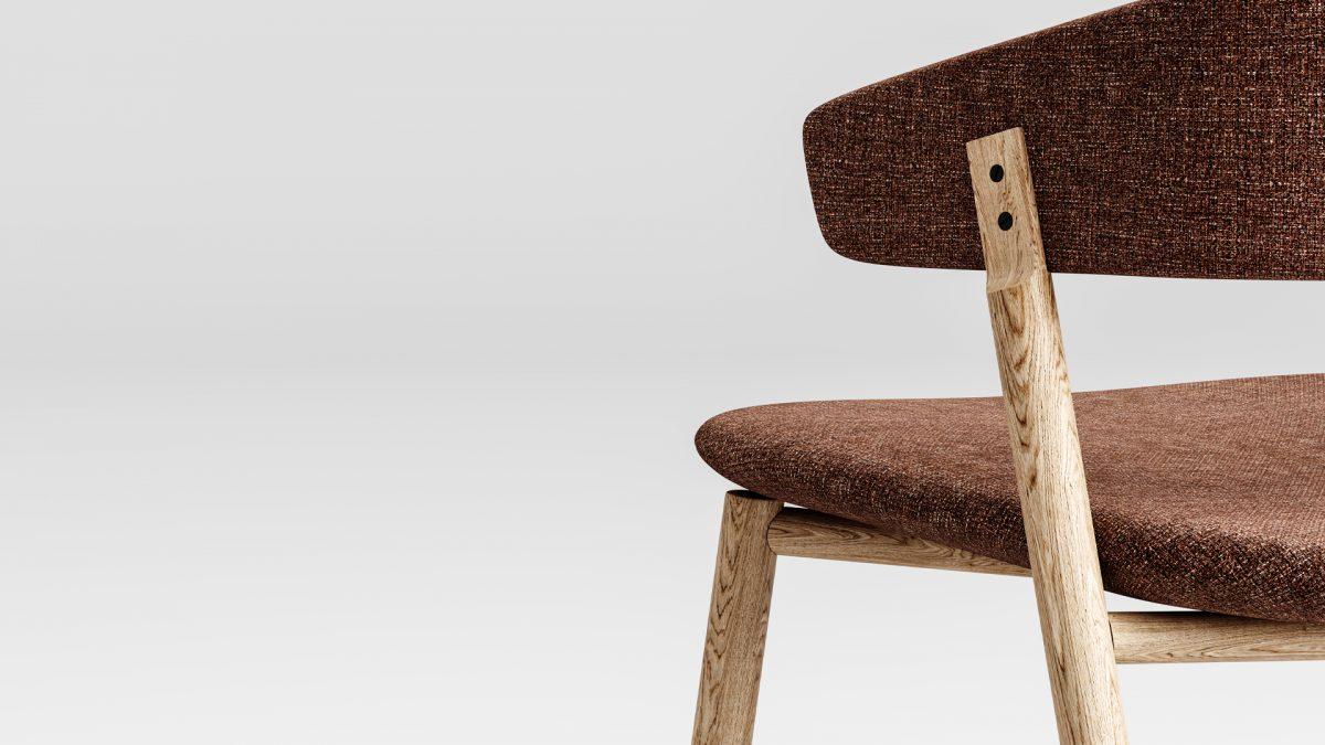 """Dettaglio dell'aggancio della struttura in legno allo schienale con i due caratteristici """"bottoni"""""""