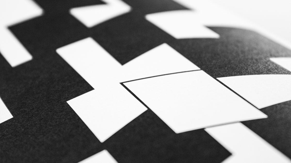 Dettaglio dell'illustrazione che rappresenta l'innovazione con il rettangolo bianco circondato da rettangoli neri