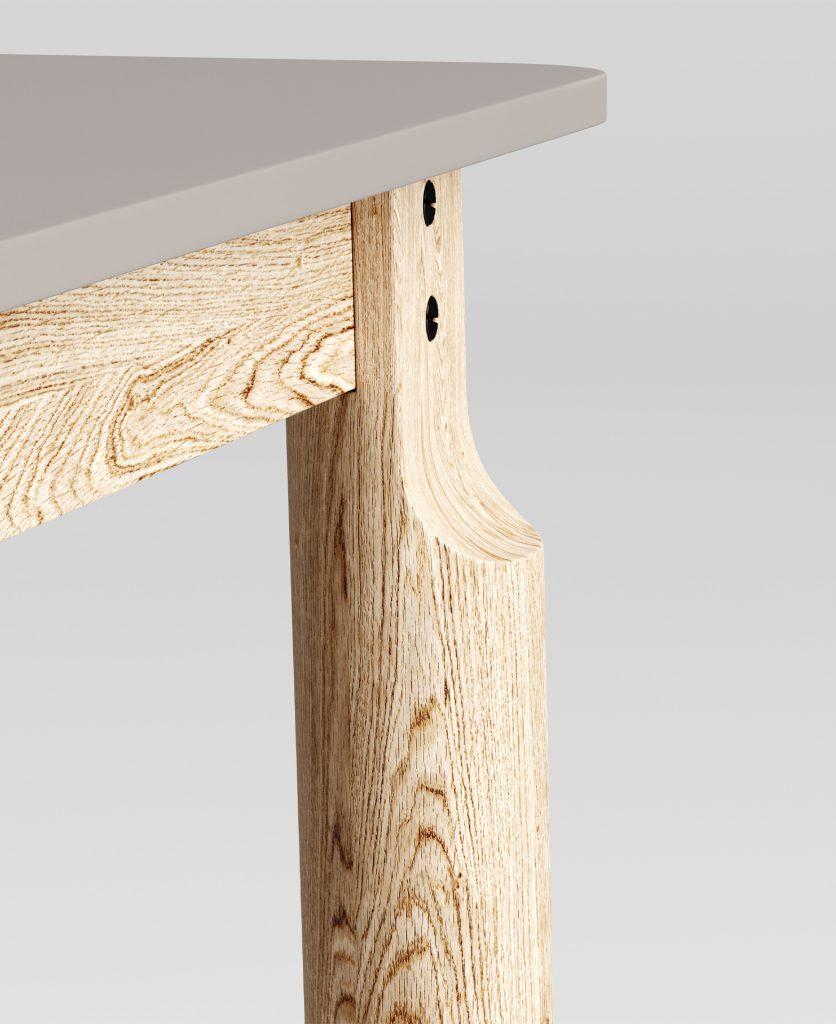 Dettaglio dell'aggancio delle gambe alla parte superiore del tavolo con i due caratteristici bottoni
