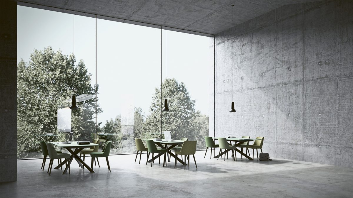 Render di un ambiente con pareti in cemento grezzo e una parete interamente vetrata al cui interno troviamo tre tavoli Maxxi e alcune sedie Fenice di Imperial Line