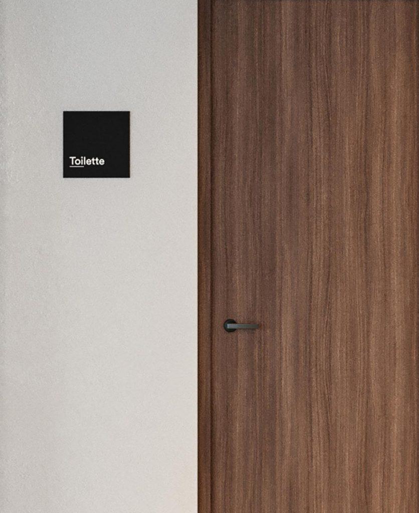 render di dettaglio della segnaletica aziendale che indica la toilette
