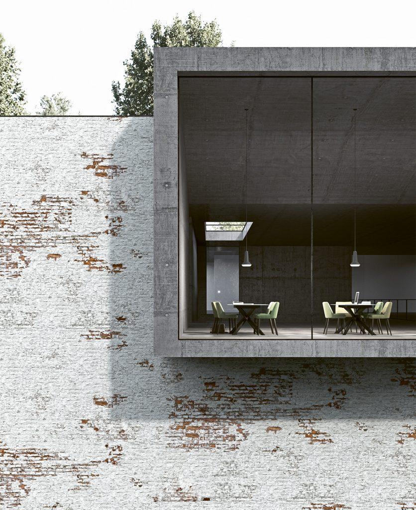 Render della vista esterna dell'edificio con muro in mattoni e una parete vetrata che mostra un ambiente in cemento grezzo